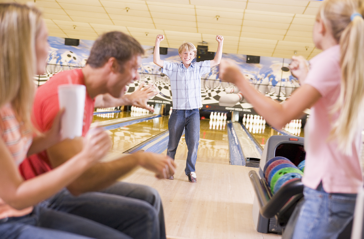 Family Enjoying Bowling Together